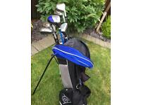 Set of various golf clubs