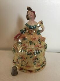 Ceramic lady in a crinoline on a separable base