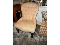 button backed cream chair