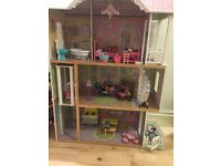 Large wooden dolls house with people and furniture