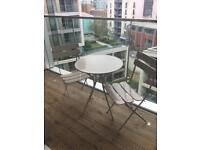 Cream outdoor table and twin chair set