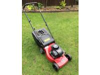 Sovereign push petrol lawn mower.