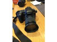 Sony A350 with 18-70mm lens, plus Sony 18-250 zoom lens and other accessories.
