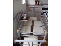 Glass and silver dining table and 6 chairs. Cream padded seats, excellent condition.
