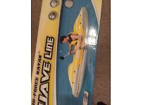 Inflateable kayak with paddle