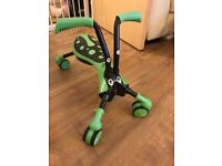 Green and black Scramblebug ride on toy