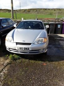 ..YES I AM FOR SALE Hyundai coupe 2.0 2002 spares or repairs £250