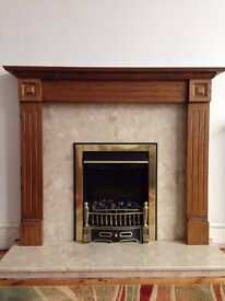 Electric fire with marble surround and wooden mantelpiece