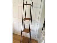Tall display unit in rattan and steel. M&S