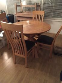 Stylish solid oak table and chairs