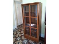 beautiful display cabinet with sliding doors , shelves and drawers can deliver