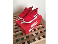 Baby red Nike trainers