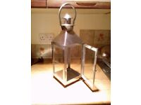 Large stainless steel candle lantern.