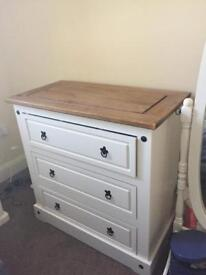 3 draw chest of draws white and wood.