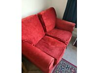 FREE TO COLLECTOR - Red two seater Collins & Hayes sofa