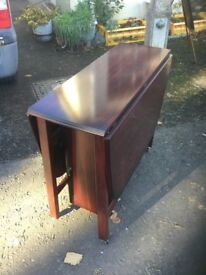 Drop leaf dining table with storage cupboards, cherry gate leg kitchen table. Up to 6 seat.