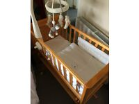 Beautiful rocking baby cradle for sale - fabulous condtion, with bedding set.