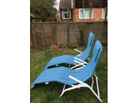 Two blue sun loungers / deck chairs