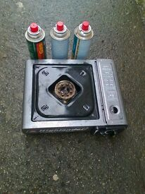 camping stove used with 4 full gas canisters