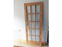 Untreated pine and toughened glass internal door with handles
