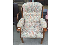 Floral armchair with wooden frame . Good Condition and Quality . Free local delivery.