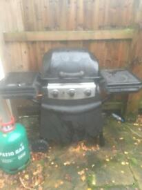 Gas bbq and full gas cylinder.