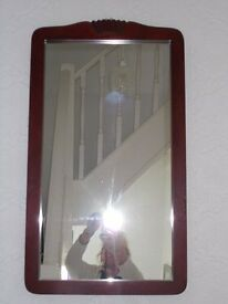 Dark wood hall mirror with moulded frame