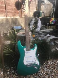 Green hand made electric guitar