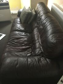 Brown leather three and two sitter sofa