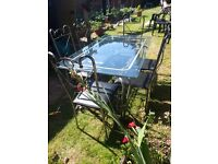 Metal and glass 6 seat dinning room table
