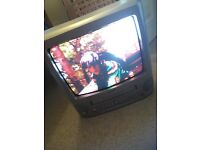 Bush TV with integrated VHS player. Various videos come with it if desired.