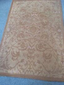 Gold coloured rug