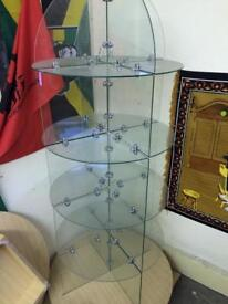 Revolving glass display unit
