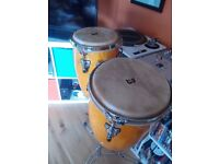 Brand new pair of congas with stand still boxed