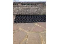Two matching Tudor rose solid stone troughs