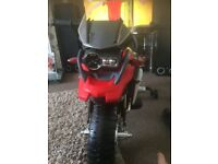 BMW R1200 GS electric motorbike red and black and silver in colour