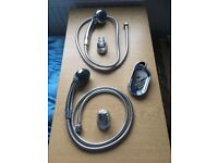 Multi function shower head and hose, with fitting to hold shower head on wall