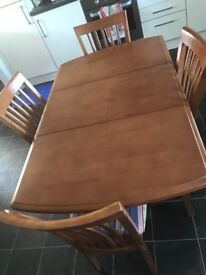 Extendable table and 4 chairs less than a year old excellent condition cream seat covers £180