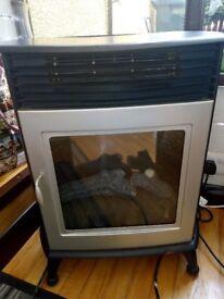 Electric fan heater log burner effect