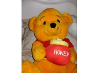 CHILD'S VERY LARGE CUDDLY BEAR- WINNIE THE POO WITH HONEY POT.