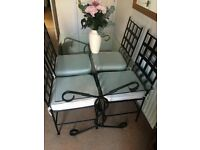 Glass top black iron effect rectangle table and four chairs