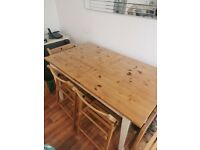 Extending dining table with 4 chairs.