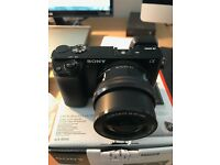 Sony A6000 with PZ 16-50 zoom lens. Excellent condition, almost as-new