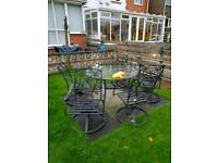 Metal table and chairs, glass top. High quality
