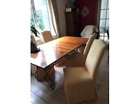 Dining table x6 covered chairs. Extends to seat 10. Must go ASAP