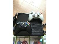 Xbox 360 console with two controllers and 10 games