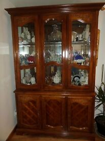 Display Cabinet Glass and wood upper section and solid sideboard 3 door lower. Contents not includ