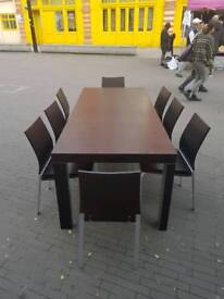 Modern style dining table with 8 chairs.
