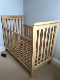 Troll bedside cot in natural finish.