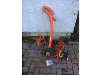 Flymo contour strimmer, lead and spare real. £15.